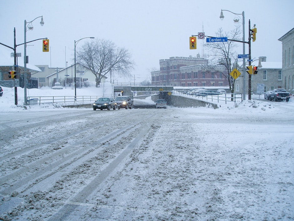 Snow all over the crossing of Carden and Wyndham Streets in Guelph