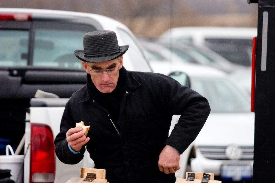An Amish man selling maple syrup, St. Jacobs traditional product.
